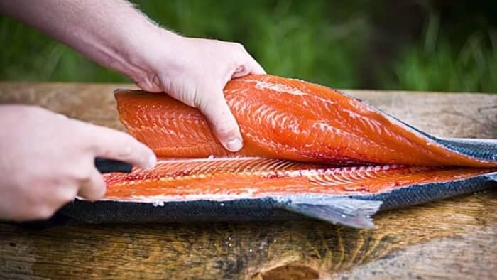 filleting and washing salmon